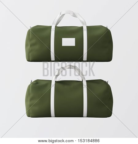 Sport fashion bag of green color with white handle isolated at the clean background.Highly detailed texture material in square photo.Empty mockup label on front side.Double sided mock up.3D rendering.