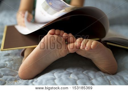 Foot closeup.An image of a toddler reading a book.