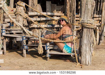Woman in bikini on tropical beach at Seychelles.