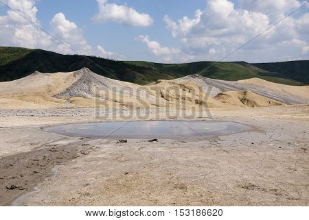 Romania Buzau Berca - Active Mud Volcanoes Muddy Volcanoes Reservation in Mountains View Landmark for Tourists Landscape (unique geological phenomenon in Europe where the earth gas reaches the surface through hills making small Mud volcanoes)