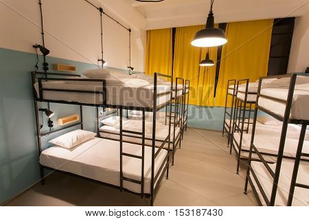 TBILISI, GEORGIA - OCT 8, 2016: Modern loft with bunk beds in youth hostel with dormitory rooms on 8 October, 2016. The annual number of tourists in Georgia reached 2300000 people