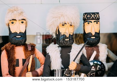 Close Three Wooden Dolls In The Similitude Of Highlanders, Caucasus Georgian Men In Traditional Clothes.