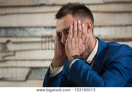 Tired Business Man At Workplace In Office Holding His Head On Ha
