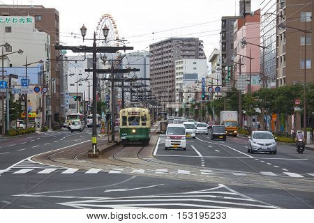 Nagasaki, Japan - August 19, 2015 Cars And Vintage Tram On The Road