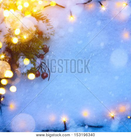 Christmas background with Christmas tree and holidays ornament on blue snow background