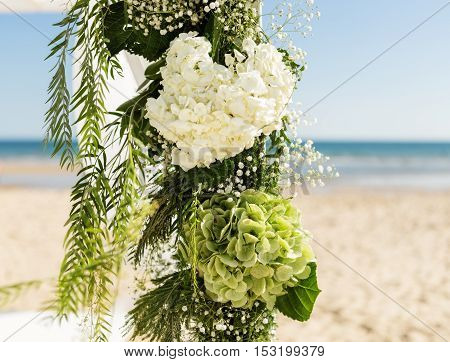 Bouquet of flowers for a wedding arch. Against the background of sky and sea.