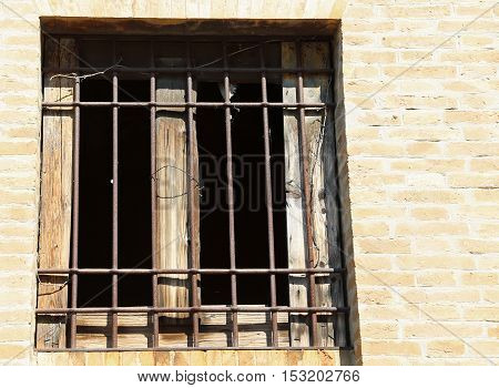 Window Of An Abandoned House With Iron Bars