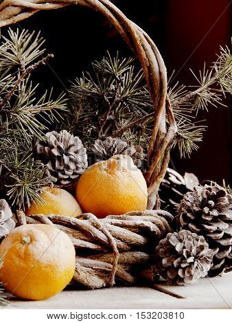 Christmas card decoration with fir branches, tangerines, pine cones, and decoration elements , selective focus