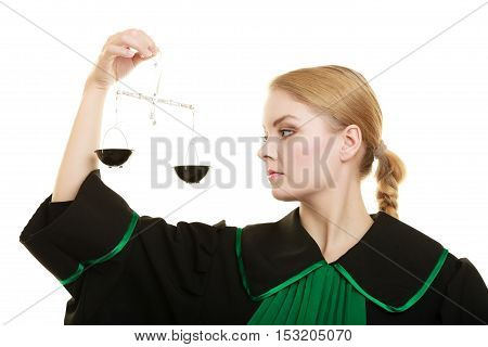 Law court concept. Woman lawyer attorney wearing classic polish black green gown holds scales. Femida - symbol sign of justice. isolated on white