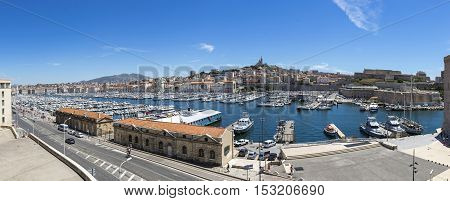 Aerial skyline panoramic view of Old Port and Basilica of Notre Dame de la Garde in Marseille city France. Marseille is a second largest city in France (after Paris)