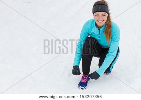 Sporty Girl Tying Shoes.