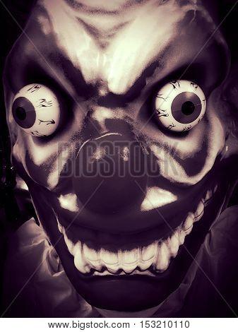 scary pop eye snarling evil prop clown