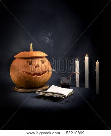 Halloween Pumpkins with a smoking cigarette in his mouth.
