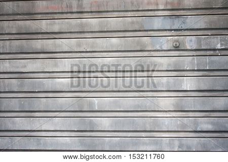 Galvanized old rusty industrial roller security door