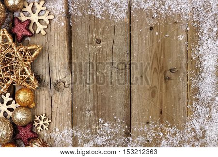 Gold Christmas Ornament Side Border With Snow Frame On A Rustic Wood Background