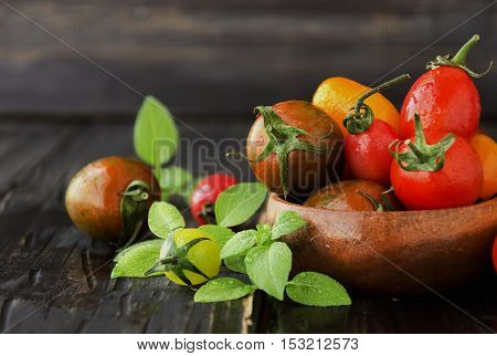 fresh tomatoes with basil on a wooden table, selective focus