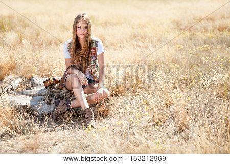 Beautiful Longhair Hippie Girl Sitting On A Tree Stump