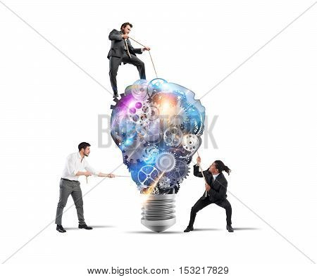 Teamwork of businesspeople work together to a lightbulb system of gears