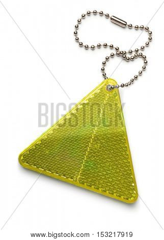 Yellow pedestrian safety reflector keyring isolated on white