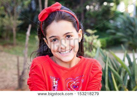Adorable caucasian girl shows big adorable smile