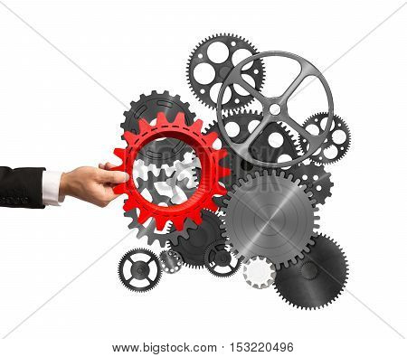 Businessman builds a business system putting a gear in a mechanism