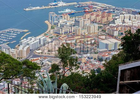 Gibraltar is a British Overseas Territory located on the southern end of the Iberian Peninsula. It  shares its northern border with Spain. The Rock of Gibraltar is the major landmark of the region.