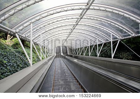 Outdoor escalator and stair with roof, close up