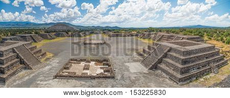 The Plaza of the Moon and the Avenue of the Dead with the Pyramid of the Sun in the distance seen from the Pyramid of the Moon at Teotihuacan Mexico.