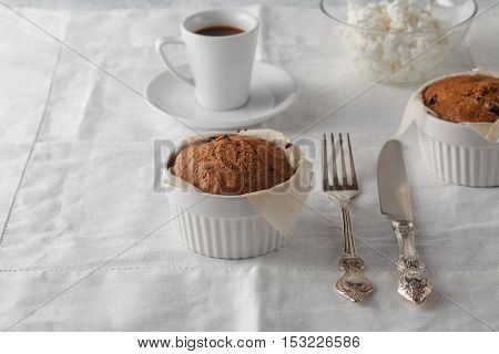 Homemade Sponge Cake With Dried Cranberries And Cup Of Coffee.selective Focus On The Sponge Cake