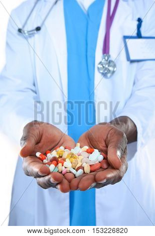 pill in a hand isolated on white background