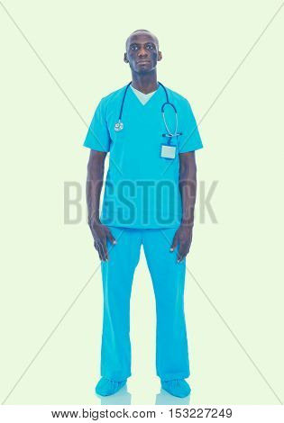 Portrait of a doctor man standing isolated on white background