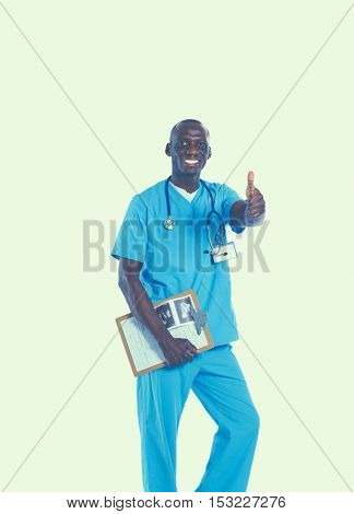 Portrait of handsome doctor holding a folder, showing Ok sign