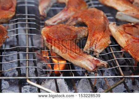 fresh raw lamb ribs on bbq grid grill cooked over charcoal