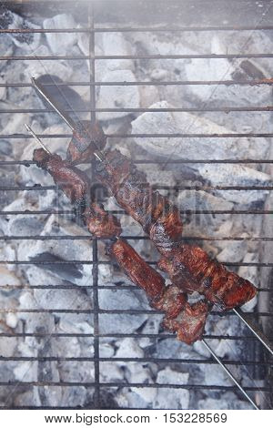 fresh beef meat kebab on barbecue grid grill cooked over burned churcoal