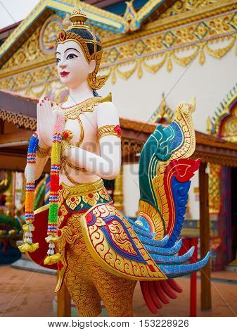 Kinnari is Half-bird - half-woman creature at south-east Asian Buddhist mythology at public temple that created with money donated by people to hire artist