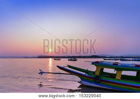 Cruise at Irrawaddy river at dawn in Bagan, Myanmar. View from Bupaya bagon, Ayeyawady river with tourist boats on river bank.