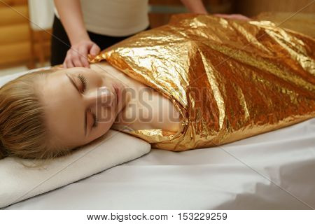 Caring about beauty and health. Body wraps in spa salon