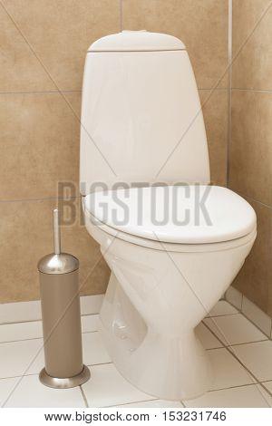 white toilet bowl in modern bathroom