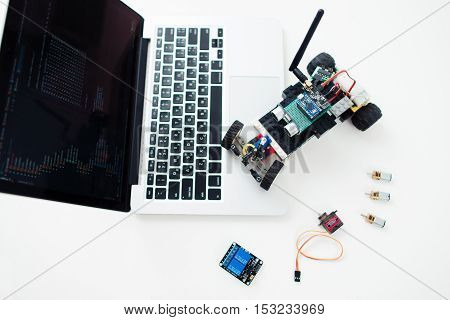 UKRAINE, KHARKIV- OCTOBER 1 , 2016. Diy rc car made on base Arduino Pro Micro microcontroller and construction Lego Technic on laptop. Electronic components on geek workplace