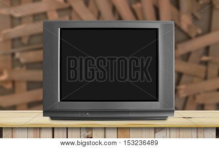modern blank black television or tv on classic wood table and fracture wooden wall background for your ideas