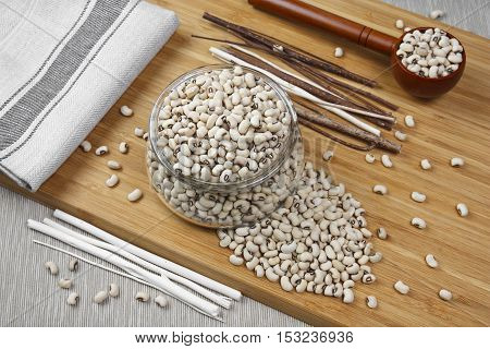 top view navy bean white kidney bean or white bean in glass cup on wood table benefits for diet weight control and diabetes because phaseolamin with space for your text or crop