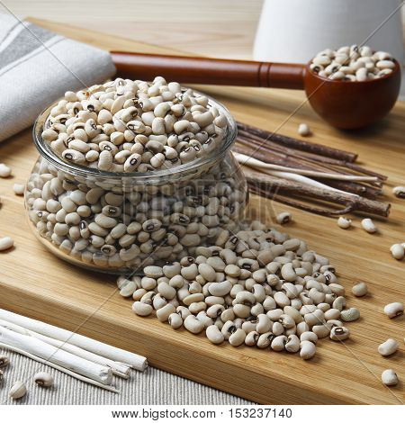 navy bean white kidney bean or white bean in glass cup on wood table benefits for diet weight control and diabetes because phaseolamin square shape