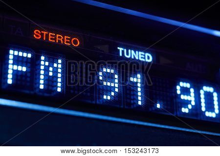 FM tuner radio display. Stereo digital frequency station tuned. Horizontal
