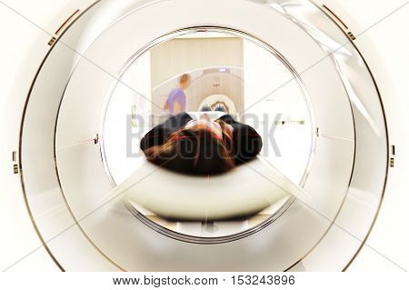 View through a MRI scanner while a patient being prepared for head scan.