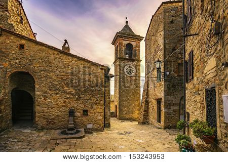 Casale Marittimo old stone village in Maremma on sunset. Picturesque flowery square and campanile tower. Tuscany Italy Europe.