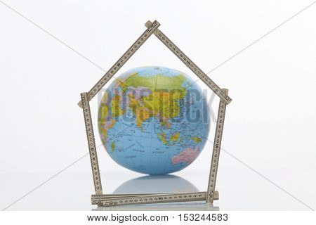Asian country  with the fold able ruler folded in to a house shape