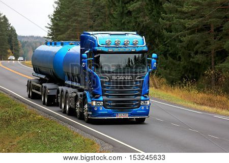 SALO, FINLAND - OCTOBER 22, 2016: Beautiful blue Scania R580 tank truck on rural road flanked by forest. Scanias new truck range wins International Truck of the Year 2017 Award.