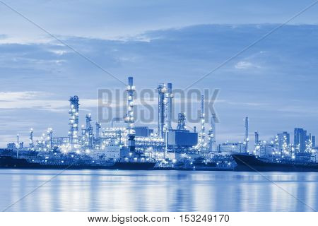 Twilight of the oil refinery plant Oil refinery blue tone.