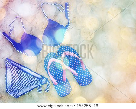 Fashionable woman swimming suit and flip flop on sand beach background vintage filter effect with bokeh