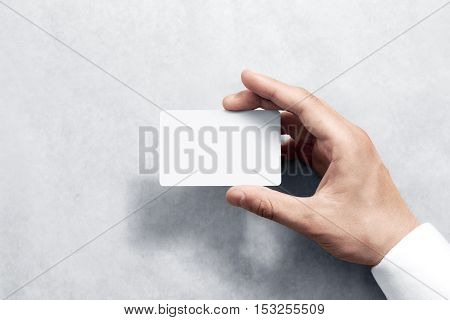 Hand hold blank white card mockup with rounded corners. Plain call-card mock up template holding arm. Plastic credit namecard display front. Check offset card design. Business branding.